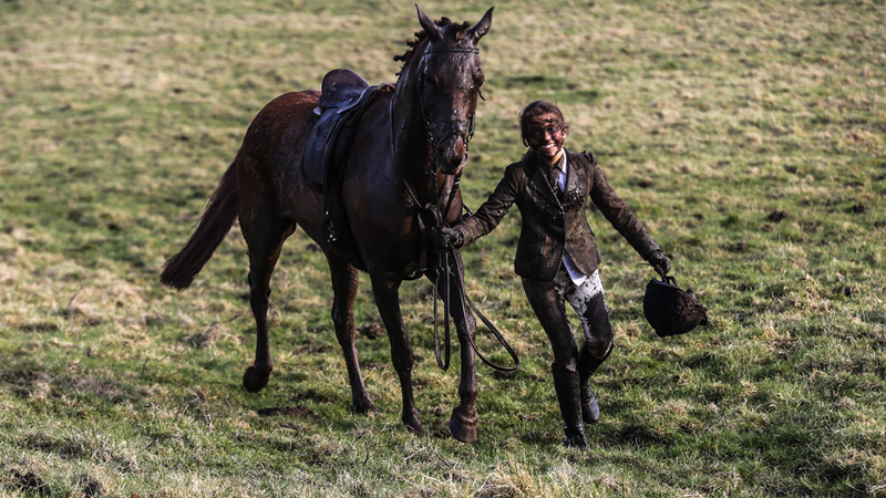 """I couldn't see anything because there was so much mud in my eyes. I tried to wipe them, but my gloves were full of mud as well."" Get the story behind this hilarious photo—it involves a pretty remarkable young rider!"